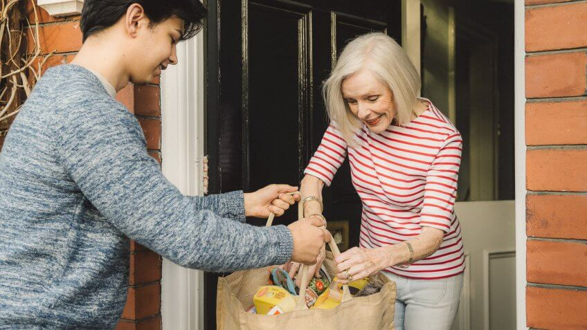 Dwell Care caregivers deliver groceries to seniors